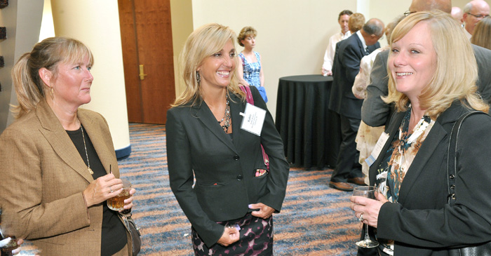 (From left) SEARCH Michigan Member Dawn Brinningstaull, chats with Katie Bower, Michigan State Police, and Angie Kendall, Texas Department of Public Safety