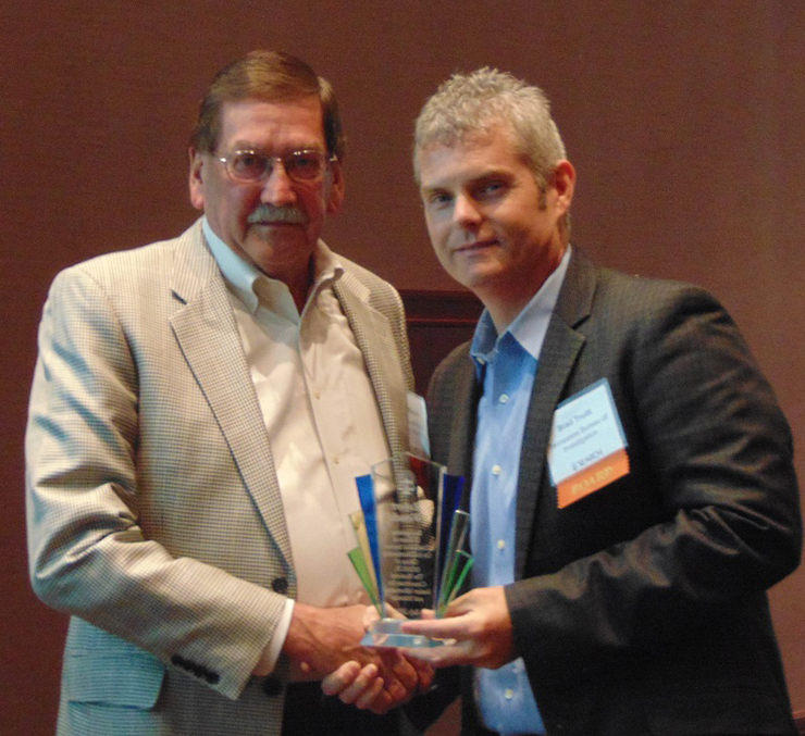 Bob Wessels accepts an award from Chair Brad Truitt recognizing his 15 years of service as a SEARCH At-Large Member.